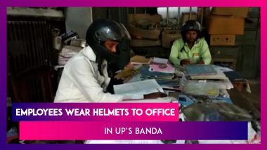 UP: Electricity Dept Employees Wear Helmets To Protect Themselves From Crumbling Building In Banda