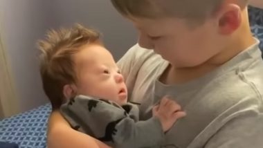 Brothers Cradles And Sings to Baby Brother With Down Syndrome, Adorable Video Goes Viral