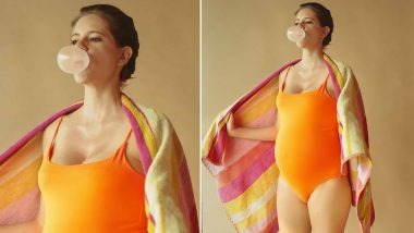 Kalki Koechlin Looks Sassy as She Flaunts Her Baby Bump in an Orange Swimsuit and a Blown Up Bubblegum! (View Pic)