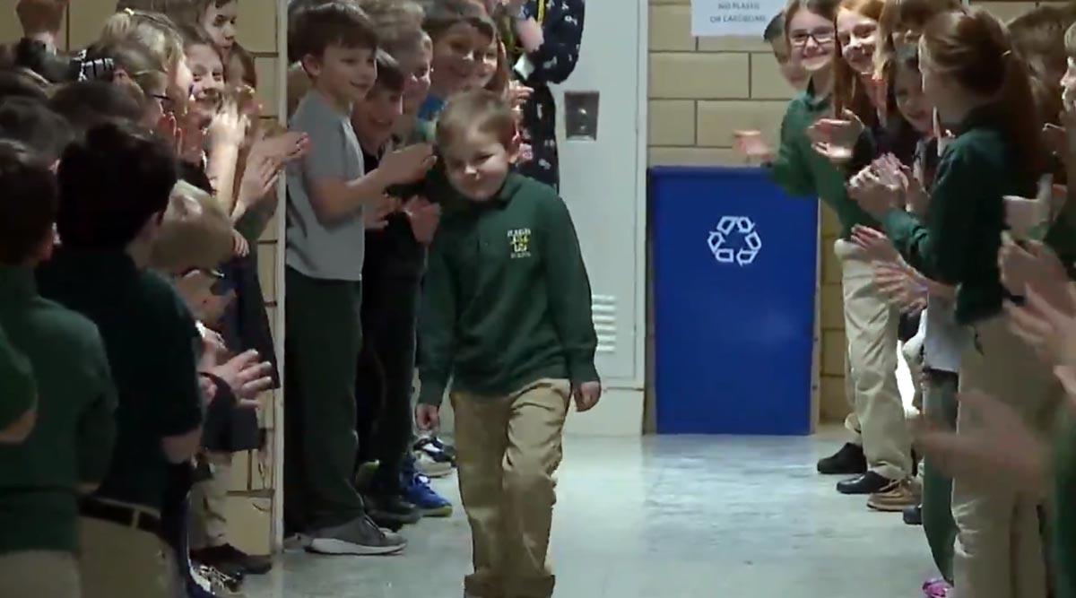 Little Boy Beats Leukemia, Classmates and Teachers Give Standing Ovation After His Final Chemo Treatment (Watch Video)