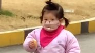 Little Girl Tries to Eat Biscuit Wearing Facemask in China, Her Perplexed Reaction Goes Viral (Watch Video)