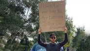 A Guy With A Sign': A Guy Silently Protests Against Most Random Issues
