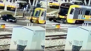 BMW Car Hit by Running Train in Los Angeles, Driver Escapes Miraculously (Watch Terrifying Viral Video)