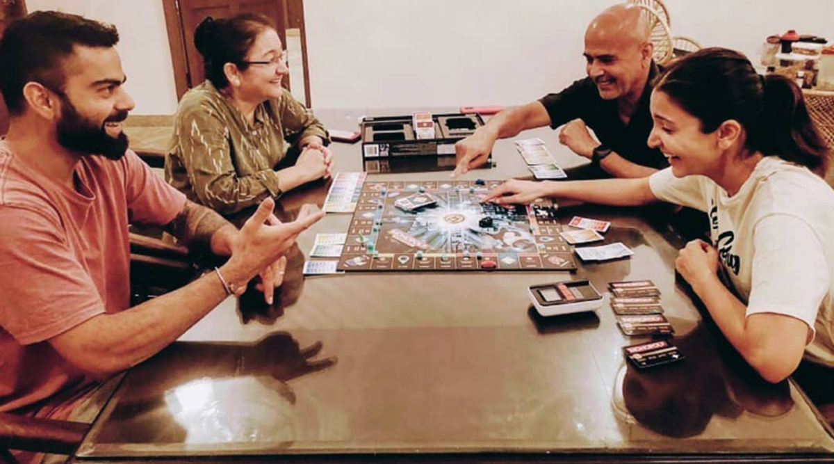 Anushka Sharma And Virat Kohli Have Their Gaming Mode On As They Play Monopoly With Family During Lockdown (View Pic)
