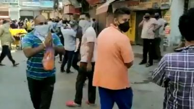 Delhi: Man Showers Petals on People Outside Liquor Shop in Chander Nagar for Helping the Economy, Government (Watch Video)