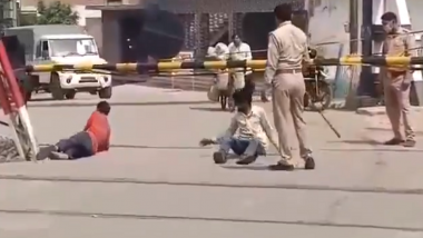 Uttar Pradesh: Cop Suspended in Hapur After Video of Him Beating Labourers and Making Them Roll On Road Goes Viral