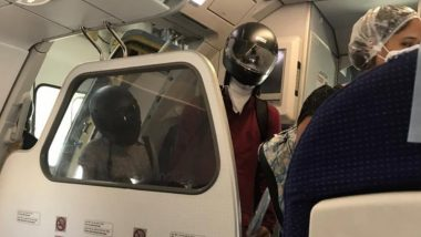 Worried Passengers Wear Motorbike Helmet While Boarding Flight to Protect Themselves From Being Infected With COVID-19, Viral Pics Inspire Meme-Fest on Twitter!
