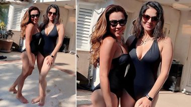 Sunny Leone Slips into her Black Monokini as She Enjoys her Swimming Date with a Friend in Los Angeles