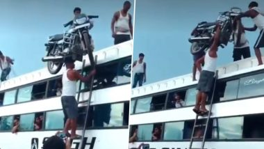 Man Carrying Bike on His Head And Climbing on Ladder to Keep it on Bus Without Any Safety Measure Goes Viral, Twitterati Are Shocked Beyond Belief (Watch Video)