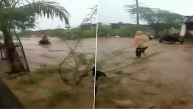 Maharashtra: Motorbike Rider in Dhule Gets Caught in Flash Flood, Rescued by Locals (Watch Video)