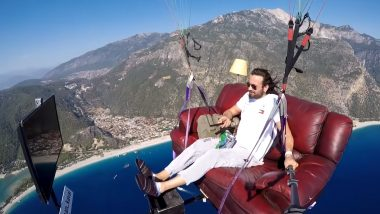 Paragliding and Chill! Turkish Paraglider Hasan Kaval Soars in Sky on Couch and Watches Tom & Jerry on TV! Crazy Video Goes Viral