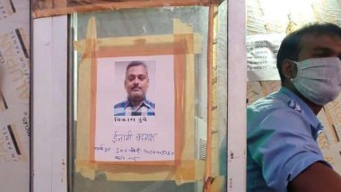 Kanpur Encounter: Photos of Main Accused Vikas Dubey Put Up at Unnao Toll Plaza by Police, Search Operation Underway to Nab History-Sheeter