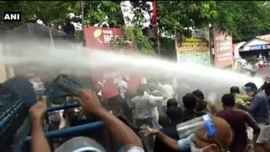 Gold Smuggling Case: Police Resort to Tear Gas & Water Cannon Against Members Protesting