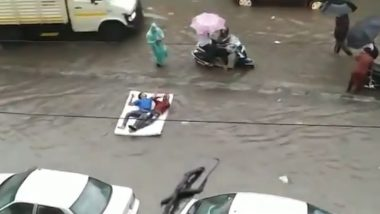 Video of Two Guys 'Floating on a Bed' in Flooded Mumbai Rains is The Best Version of Desi Titanic You'll See (Check Funny Reactions)