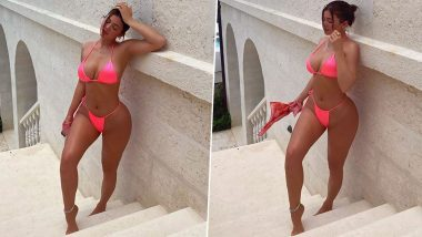 Kylie Jenner's Pictures in Her Neon Pink Bikini are Screaming Hotness