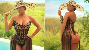 XXX-Tra Hot! Demi Rose Flaunts Big Booty and Tiny Waist in Tiger Print Lace-Up Leotard During African Vacation, View Photos