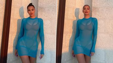 Khloe Kardashian Shows Off Her Sexy Curves in a Sheer Blue Skintight Coverup (View Pics)