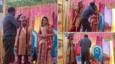 Say Cheese! Indian Bride Laughs Uncontrollably as Groom Beats up Cameraman for Getting Too Comfortable with His Would-Be Wife! Viral Video Is Cracking up Netizens