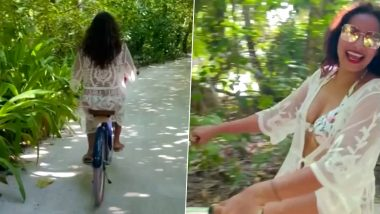 Bipasha Basu Enjoys a Fun Cycling Session Around Maldives (Watch Video)