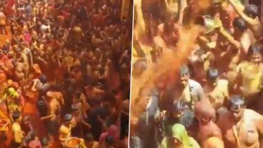 Holi 2021 Celebrations: Devotees Play 'Kapda Fad' Holi in Premises of Dauji Temple in Baldeo Area of Mathura District in Uttar Pradesh (Watch Video)