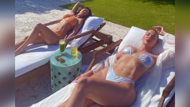 Kourtney and Khloe Kardashian Are Soaking the Sun in Bikinis and This Super Sexy Photo Is a Proof