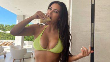 Kim Kardashian Is a Sight to Behold in This Neon Bikini (See Pic)