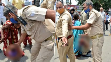Meerut Policeman Seen Holding Baby in Objectionable Manner While Mediating Between 2 Groups, Probe Ordered After Images Go Viral