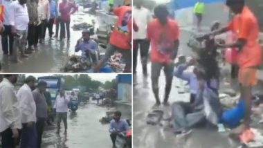 Dilip Lande, Shiv Sena MLA From Chandivali, Makes Contractor Sit on Waterlogged Road; Tells Workers To Dump Garbage on Him (Watch Video)