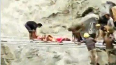 Himachal Pradesh Rains: Local Villagers and Members of Disaster Rescue Team Carries Injured Person Across Raging Jahalman Nallah (Watch Video)