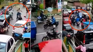 Assam: Policeman With Umbrella in Hand Chases Biker at RNB Road in Kokrajhar, Video Goes Viral