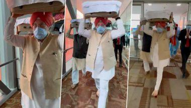 Hardeep Singh Puri Carries Shri Guru Granth Sahib, Flown From Kabul, At Delhi Airport (Watch Video)