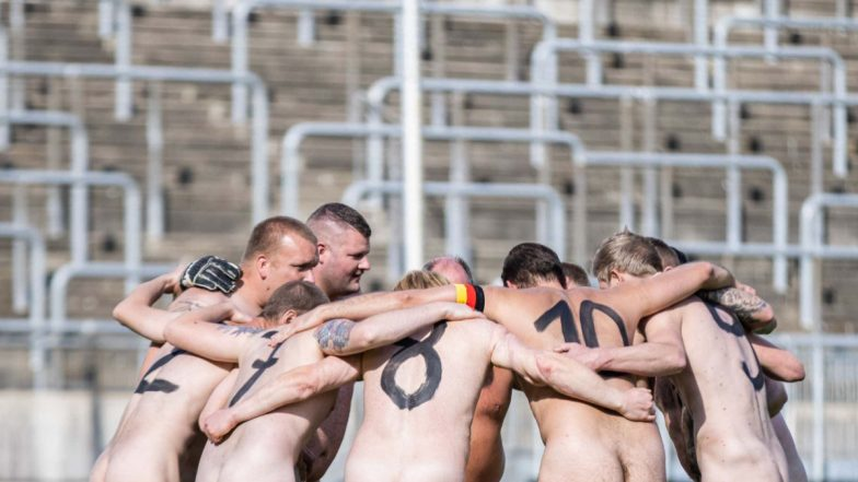 Germanys naked football team with the message protesting