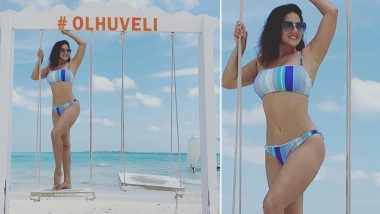 Sunny Leone Enjoys Swing Time In a Sexy Blue Striped Bikini, Shares Enticing Snap From Maldives Vacation