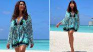 Bipasha Basu Enjoys the White Maldivian Sand in a Blue Floral Mini Dress (View Pics)