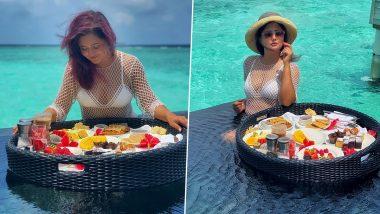 Rashami Desai Stuns in a White Bikini as She Enjoys Food in Beach of Maldives! (View Pics)